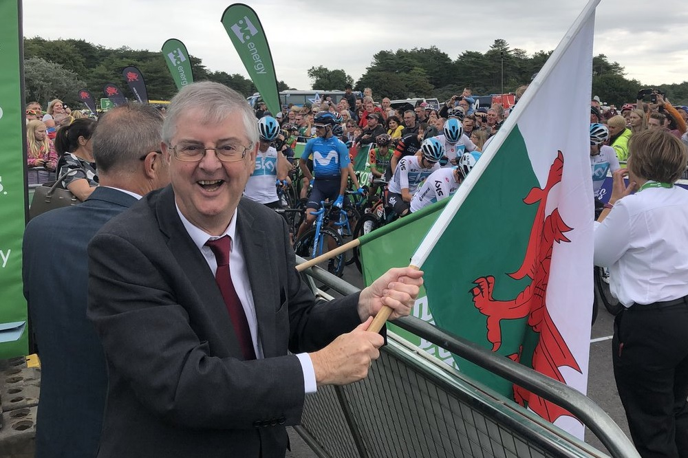 Picture of Mark Drakeford holding Welsh flag